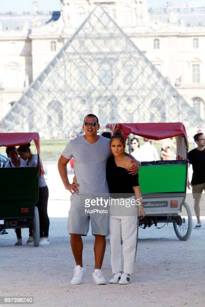 Jennifer Lopez and Her boyfriend Alex Rodriguez walk through the park of Jardin des Tuileries and seen taking pictures with the Pyramide of Louvre in...