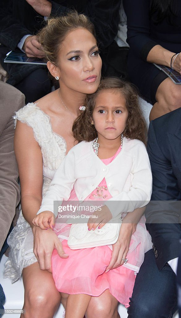 Jennifer Lopez (R) and her daughter Emme Maribel Muniz attend the Chanel Spring / Summer 2013 show as part of Paris Fashion Week at Grand Palais on October 2, 2012 in Paris, France.