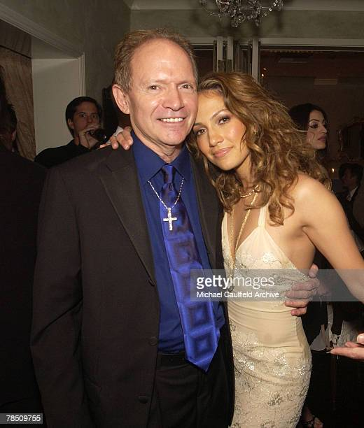 Jennifer Lopez and her father David Lopez during the grand opening party for her restaurant Madre's in Pasadena California April 12 2002