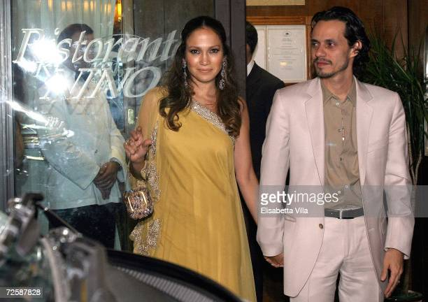 Jennifer Lopez and her husband Marc Antony leave a restaurant in central Rome after a dinner with Katie Holmes and Tom Cruise November 17 2006 in...