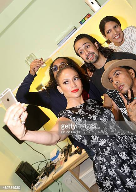 Jennifer Lopez and Lin Manuel Miranda take a selfie with guests backstage at the hit new musical Hamilton on Broadway at The Richard Rogers Theater...