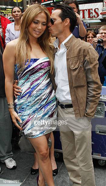 Jennifer Lopez and Marc Anthony attend the unveiling of the 'Be Extraordinary ' billboard for Boys and Girls Clubs in Times Square on June 10 2010 in...