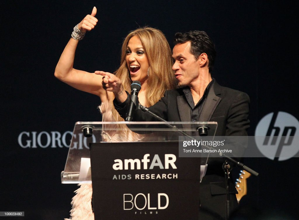 Jennifer Lopez and Marc Anthony speak during amfAR's Cinema Against AIDS 2010 benefit gala at the Hotel du Cap on May 20, 2010 in Antibes, France.