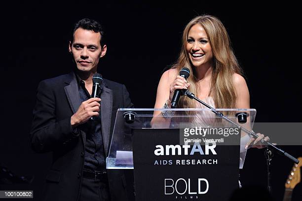 Jennifer Lopez and Marc Anthony speak during amfAR's Cinema Against AIDS 2010 benefit gala at the Hotel du Cap on May 20 2010 in Antibes France