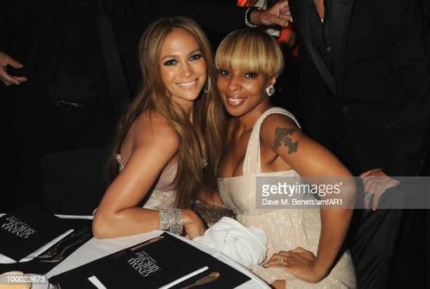 Jennifer Lopez and Mary J. Blige arrive at amfAR's Cinema Against AIDS 2010 benefit gala at the Hotel du Cap on May 20, 2010 in Antibes, France.