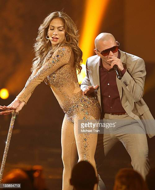 Jennifer Lopez and Pitbull perform onstage at the 2011 American Music Awards held at Nokia Theatre LA Live on November 20 2011 in Los Angeles...
