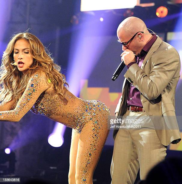 Jennifer Lopez and Pitbull perform onstage at the Nokia Theatre LA LIVE on November 20 2011 in Los Angeles California