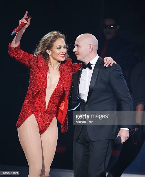 Jennifer Lopez and Pitbull perform onstage during the 2014 American Music Awards held at Nokia Theatre LA Live on November 23 2014 in Los Angeles...