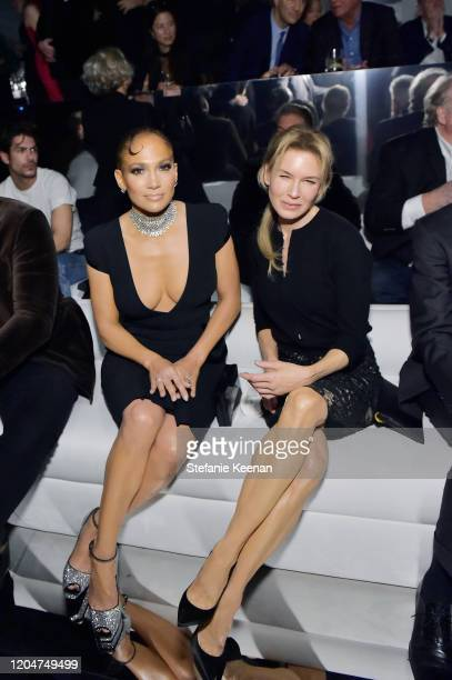 Jennifer Lopez and Renée Zellweger attend Tom Ford: Autumn/Winter 2020 Runway Show at Milk Studios on February 07, 2020 in Los Angeles, California.