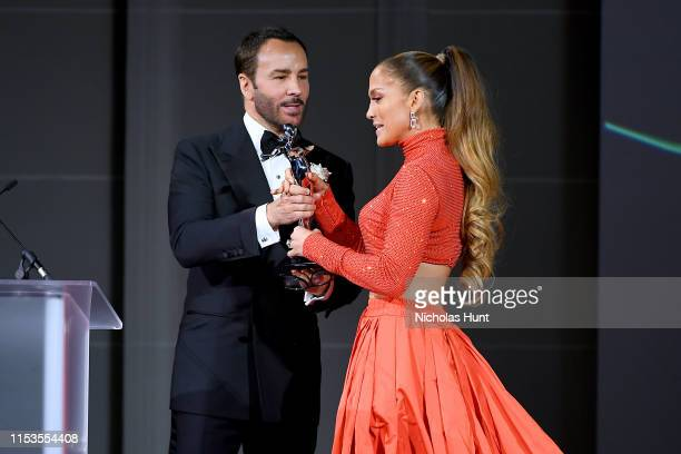 Jennifer Lopez and Tom Ford appear onstage during the CFDA Fashion Awards at the Brooklyn Museum of Art on June 03 2019 in New York City