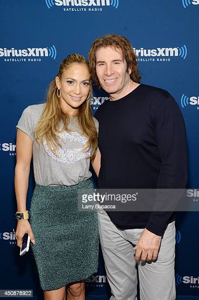 Jennifer Lopez and Vice President Music Programming SiriusXM Kid Kelly attend the SiriusXM Town Hall on June 19 2014 in New York City