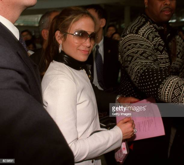 Jennifer Lopez arrives at Hong Kong International Airport February 18 2001 in Hong Kong as part of a promotional tour for her latest album