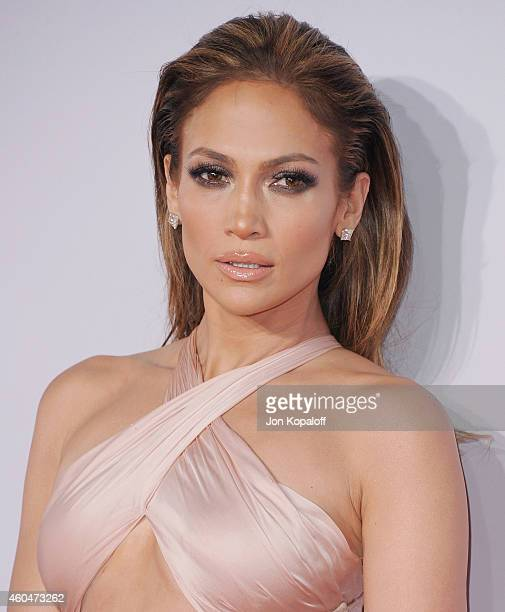 Jennifer Lopez arrives at the 2014 American Music Awards at Nokia Theatre LA Live on November 23 2014 in Los Angeles California