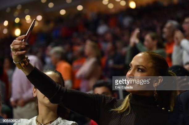 Jennifer Lopez attends the basketball game between the Duke Blue Devils and the Miami Hurricanes at The Watsco Center on January 15 2018 in Miami...