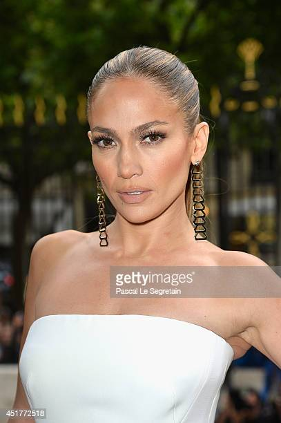 Jennifer Lopez attends the Versace show as part of Paris Fashion Week Haute Couture Fall/Winter 20142015 on July 6 2014 in Paris France