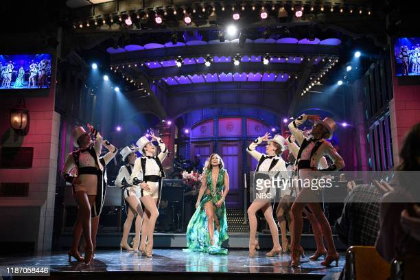 """Jennifer Lopez"""" Episode 1775 -- Pictured: Host Jennifer Lopez with The Rockettes during the Monologue on Saturday, December 7, 2019 --"""