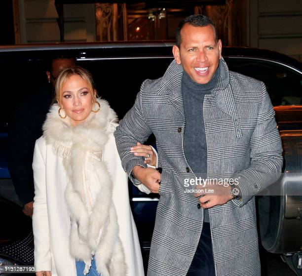 Jennifer Lopez flashes her big engagement ring when out for dinner with Alex Rodriguez on March 17, 2019 in New York City.