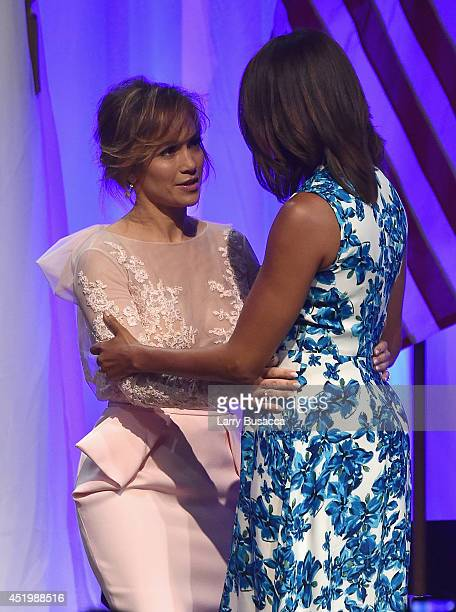 Jennifer Lopez greets First Lady of the United States Michelle Obama onstage at the LULAC/NUVOtv Unity Luncheon With Jennifer Lopez at New York...