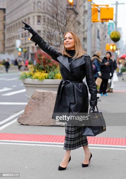 Jennifer Lopez hails a cab on the set of 'Second Act' on December 8 2017 in New York City