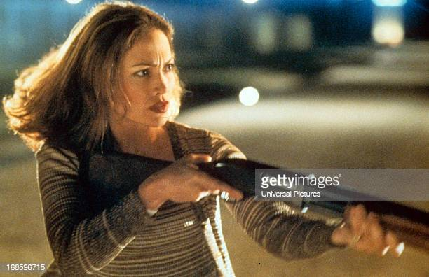 Jennifer Lopez holding rifle in a scene from the film 'Out Of Sight' 1998