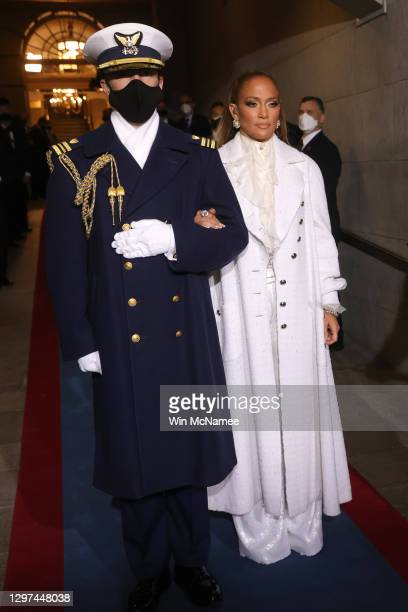 Jennifer Lopez is escorted to the inauguration of U.S. President-elect Joe Biden on the West Front of the U.S. Capitol on January 20, 2021 in...