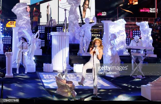 Jennifer Lopez kicks her coat off the stage as she performs in Times Square on New Year's Eve on December 31, 2020 in New York City.