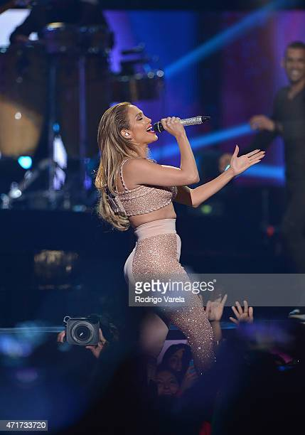 Jennifer Lopez performs musical tribute to Selena while performing with Los Dinos onstage at the 2015 Billboard Latin Music Awards presented bu State...