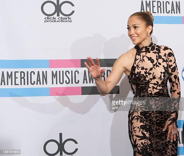 Jennifer Lopez poses after winning Best Latin Music Artist award in the press room during the 2011 American Music Awards at the Nokia Theatre LA Live...