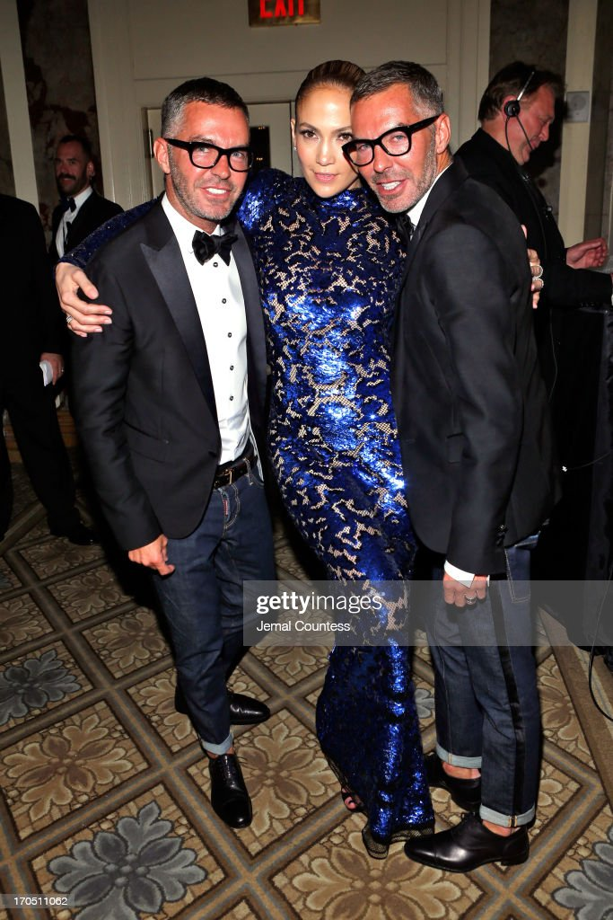 Jennifer Lopez poses with Dean Caten and Dan Caten of Dsquared2 at the 4th Annual amfAR Inspiration Gala New York at The Plaza Hotel on June 13, 2013 in New York City.