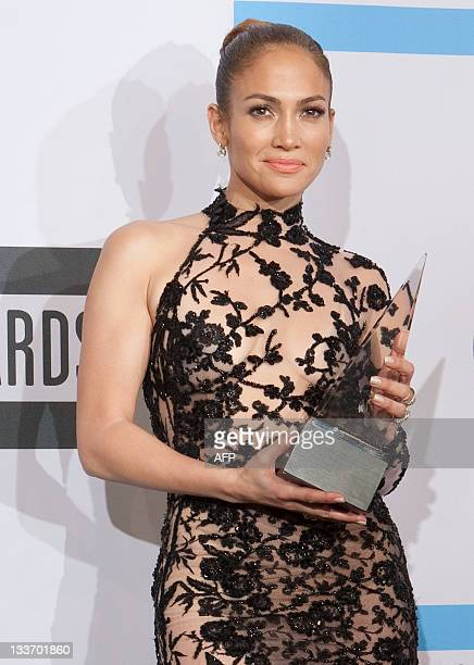 Jennifer Lopez poses with her Best Latin Music Artist award in the press room during the 2011 American Music Awards at the Nokia Theatre LA Live on...