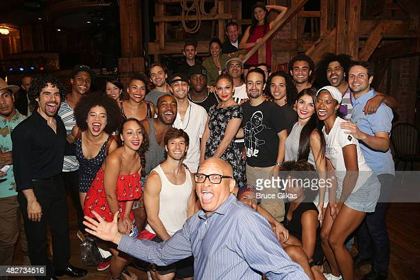 Jennifer Lopez poses with the cast as Comedy Central's The Nightly Show star Larry Wilmore photobombs backstage at the hit new musical Hamilton on...