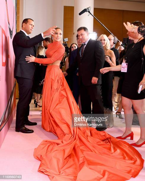 Jennifer Lopez poses with the Fashion Icon Award and Alex Rodriguez during Winners Walk during the CFDA Fashion Awards at the Brooklyn Museum of Art...