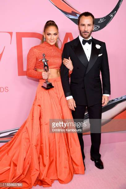 Jennifer Lopez poses with the Fashion Icon Award and Tom Ford during Winners Walk during the CFDA Fashion Awards at the Brooklyn Museum of Art on...