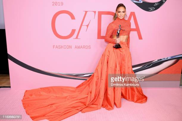 Jennifer Lopez poses with the Fashion Icon Award during Winners Walk during the CFDA Fashion Awards at the Brooklyn Museum of Art on June 03 2019 in...
