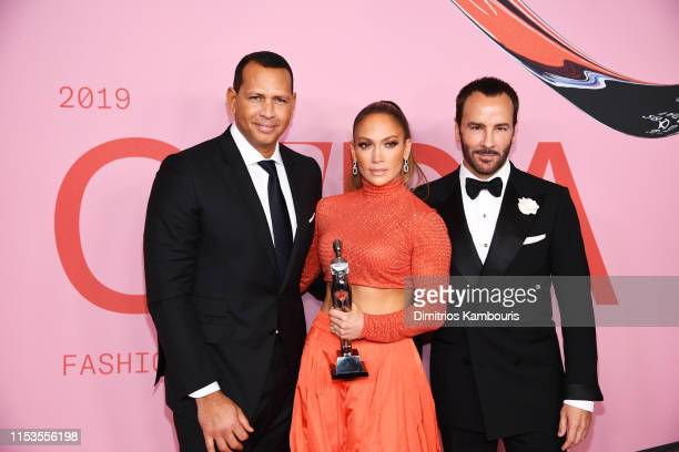 Jennifer Lopez poses with the Fashion Icon Award Tom Ford and Alex Rodriguez during Winners Walk during the CFDA Fashion Awards at the Brooklyn...