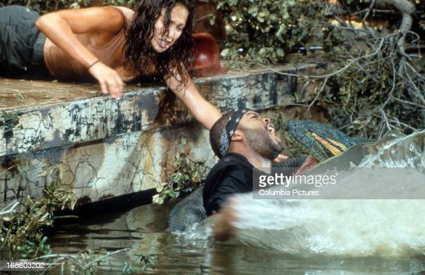 Jennifer Lopez reaching for Ice Cube as he's attacked in scene from the film 'Anaconda' 1997