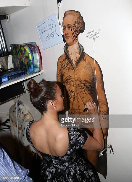 Jennifer Lopez signs the wall backstage at the hit new musical Hamilton on Broadway at The Richard Rogers Theater on August 1 2015 in New York City