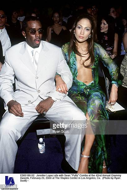 Jennifer Lopez sits with Sean Puffy Combs at the 42nd Annual Grammy Awards February 23 2000 at The Staples Center in Los Angeles Ca
