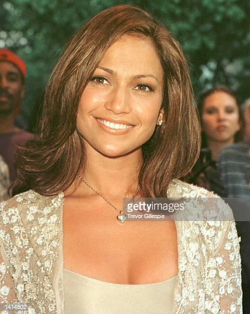 Jennifer Lopez smiles for photographers at the premiere of the movie Out of Sight in New York City June 24 1998