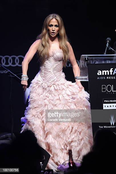 Jennifer Lopez speaks during amfAR's Cinema Against AIDS 2010 benefit gala at the Hotel du Cap on May 20, 2010 in Antibes, France.