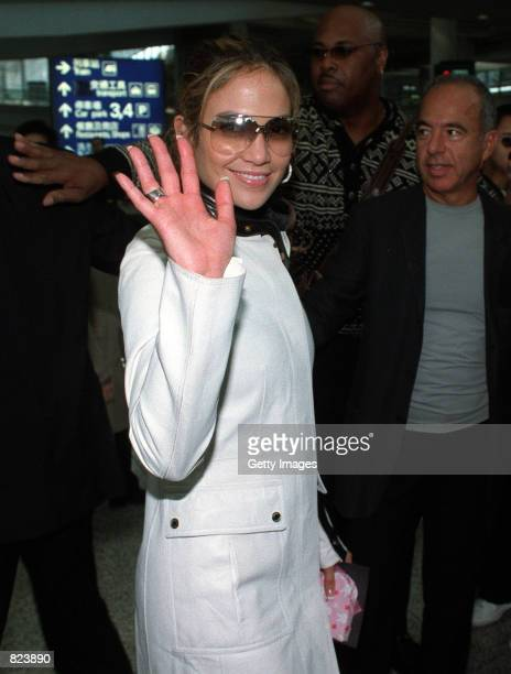 Jennifer Lopez waves as she arrives at the Hong Kong International Airport February 18 2001 in Hong Kong Lopez is in China to promote her latest album