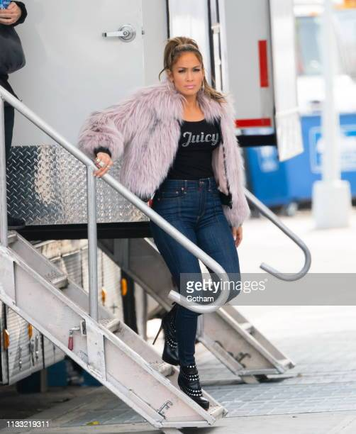 Jennifer Lopez wears a furry jacket and a shirt titled 'Juicy' on location for 'Hustlers' on March 27 2019 in New York City