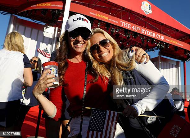 Jennifer Mackay and Amy Mickelson pose during the closing ceremony of the 2016 Ryder Cup at Hazeltine National Golf Club on October 2 2016 in Chaska...
