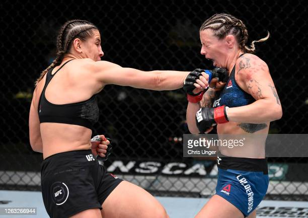 Jennifer Maia of Brazil punches Joanne Calderwood of Scotland in their flyweight fight during the UFC Fight Night event at UFC APEX on August 01 2020...