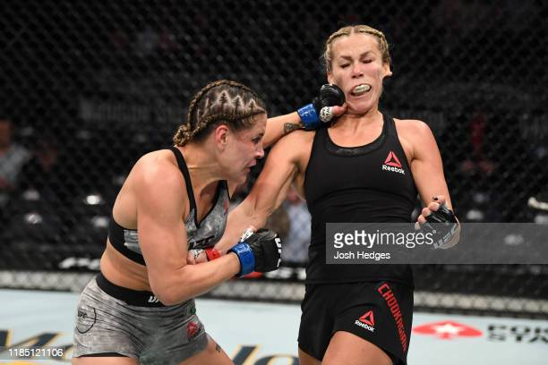 Jennifer Maia of Brazil punches Katlyn Chookagian in their women's flyweight bout during the UFC 244 event at Madison Square Garden on November 02...