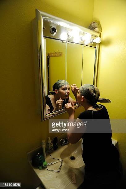 Jennifer Marlowe applies fake eyelashes at the house Phoenix Arizona Friday afternoon. Jennifer lost her eyelashes to chemotherapy, Marlowe was...