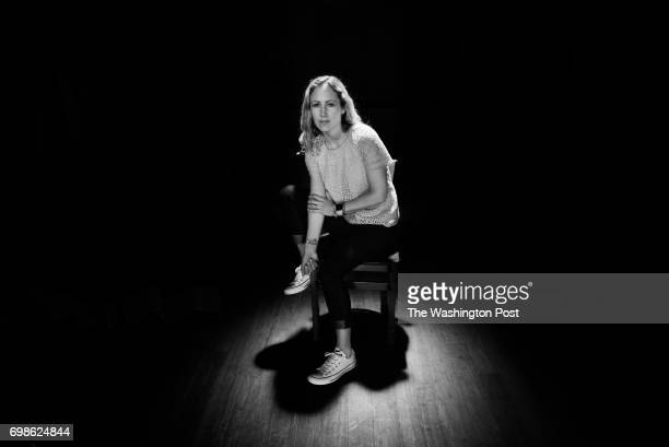 Jennifer Marshall who suffers from Type 1 Bipolar Disorder poses on the stage at Busboys and Poets on Tuesday April 12 2016 in Washington DC Marshall...