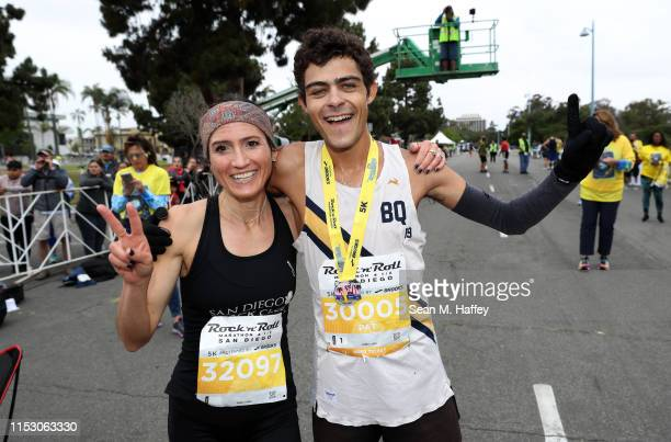 Jennifer Mercer and Patrick Hutton celebrate after finishing first in the Synchrony Rock'n'Roll 5K Presented by Brooks on June 01 2019 in San Diego...