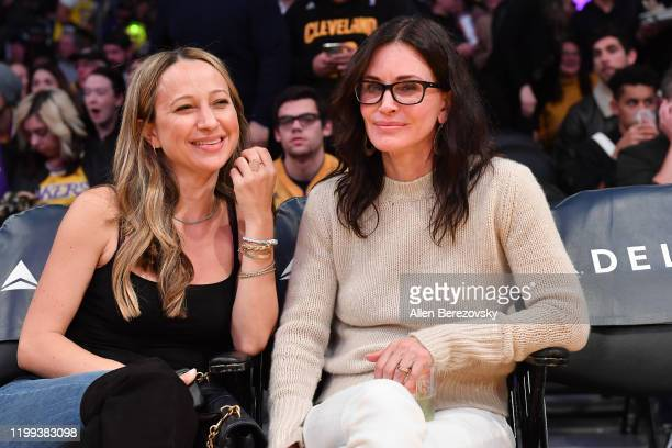 Jennifer Meyer and Courtney Cox attend a basketball game between the Los Angeles Lakers and the Cleveland Cavaliers at Staples Center on January 13...