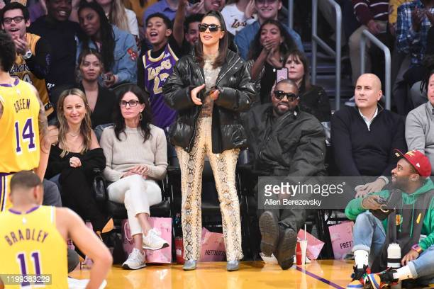 Jennifer Meyer Courtney Cox Kim Kardashian and Kanye West attend a basketball game between the Los Angeles Lakers and the Cleveland Cavaliers at...